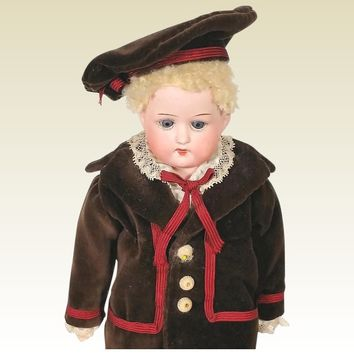 German closed mouth bisque head boy in regional costume