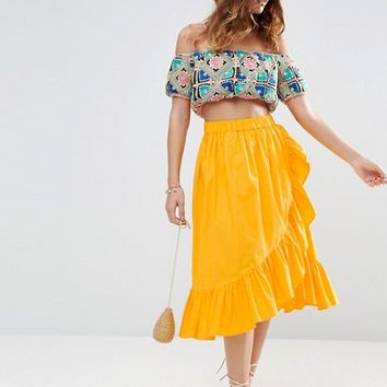 ASOS Wrap Midi Skirt in Cotton with Ruffle Hem at asos.com