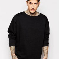 ASOS Oversized Sweatshirt With Boat Neck In Black at asos.com