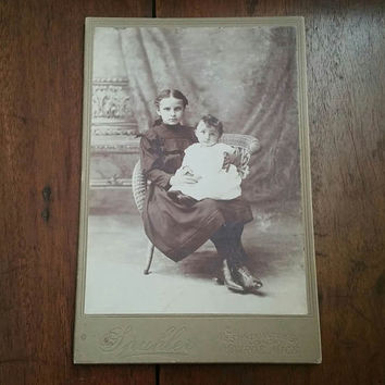 Adorable young Victorian girl and baby cabinet card