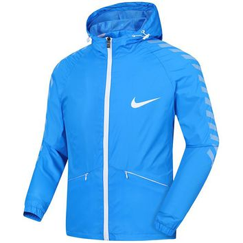 NIKE spring and autumn thin sports and leisure running men's hooded loose breathable windbreaker blue