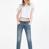 RELAX FIT MID-RISE JEANS