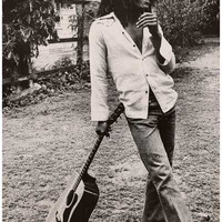 Bob Marley Leaning on Guitar Poster 12x18