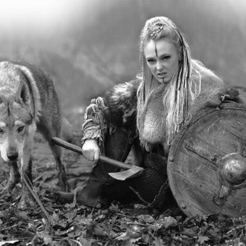 Ruthless northern warrior woman with blonde hair in a traditional clothes with fur collar with shield, ax, and her pet wolf in the forest - Airbrush Stencil