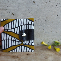 African print wallet for women. Fabric wallet in mustard and black with recycled leather flap. Unisex coin purse