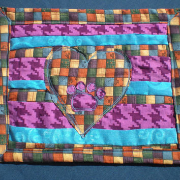 purple and teal paw prints in your heart quilted mug rug made from repurposed fabrics