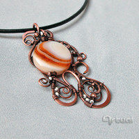 Hammered copper wire pendant with striped agate bead