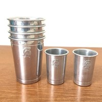 Set of vintage knights head aluminum travel bar cups, four small tumblers and two shot glasses