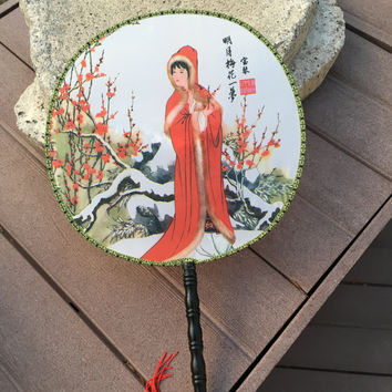 Feng Shui Hand Fan with Chinese Beauty in a Red Hooded Coat