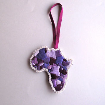Africa Christmas ornament hand embroidered using a variety of beautiful purple colors on cream muslin with a thick purple felt back