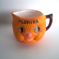 Vintage Florida Orange Small Pitcher Chalkware Some Slight Wear Measurements Are 3 And 1/4  X 2 And 1/8  X 2 and 1/4 Inches