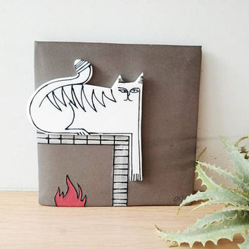 White cat wall hanging, porcelain cat in grey background, square wall tile of stoneware and porcelain, cat on the fireplace, cat art object