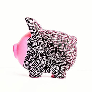 Piggy bank: pink and black piggy bank with butterfly