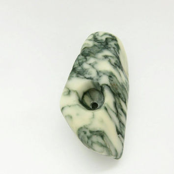 green and white marble stone pipe