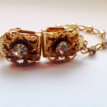 Lovely Vintage gold tone filagree flowers with diamond rhinestone centers  sweater guard or clips