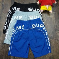 Supreme pair beach pants outdoor leisure sports waterproof thin light soft breathable shorts men's and women's loose version of the five-point pants