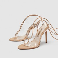 VINYL HIGH-HEEL SANDALS WITH TIES DETAILS