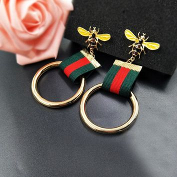 Europe and the United States temperament metal ring fabric striped earrings nightclubs ladies red and green bee earrings earring