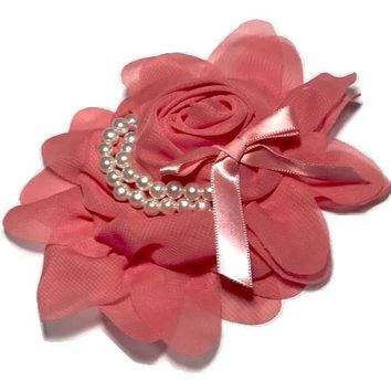 "Coral 4.5"" X 4"" chiffon rolled rose with pearl stands"