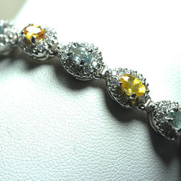 Sterling Silver 925 Multi Sapphire Bracelet.Multi Colors sapphire with Zircons. 7.5 inch Size. Very Catch Design with beautiful Colors.