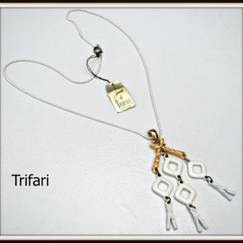 Vintage Trifari White Enamel and gold articulated necklace