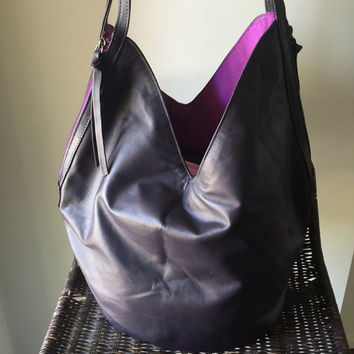 Super soft lambskin leather bag. Two toned and easy to open with twin zippers and zip pulls this stylish handbag holds everything you need.