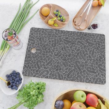 Black and faux silver swirls doodles Cutting Board by savousepate
