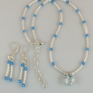 Sky Blue Swarovski Crystals and Silver Earrings on Silver Leverback Ear Wires -- Product E092