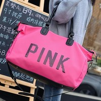 VS PINK new travel bag comes with a large carry-on bag with bright letters
