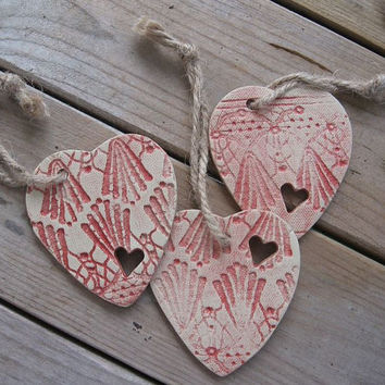 Set of 3 pottery heart ornaments, gift tags.  Handmade.  Red highlights.