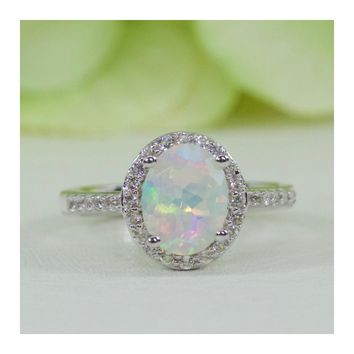 Sterling Silver Natural Ethiopian Opal And White Topaz Halo Ring