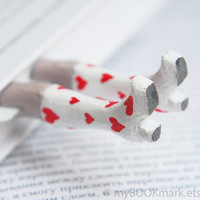 Legs in the book.   White boots with red hearts for her. Funny St. Valentines day gift