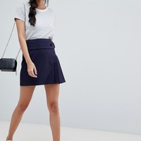 ASOS DESIGN kilt mini skirt with self belt and pleats at asos.com