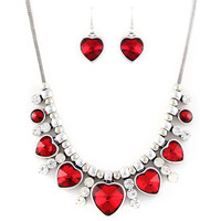 "red crystal heart necklace and earring set at Joji Boutique: 16"" silver snake chain with 3"" extender chain. 5 beveled red heart charms graduating from 1cm to 2cm, with clear bejeweled spacer charms. Matching red stone heart earrings. #jewelry #joji #fashio"