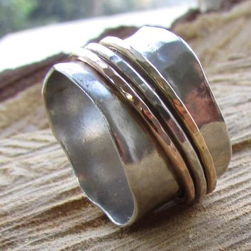 Three Hammered Spinning Rings on a Silver Ring