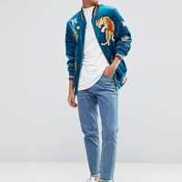 ASOS Bomber Jacket in Velvet Quilt with Embroidered Badges at asos.com