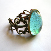 Solid brass filigree ring, baby blue glass stone
