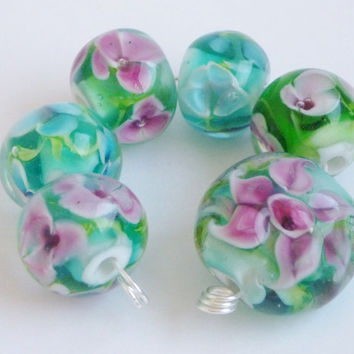 Lampwork Glass Bead Set in teal and pink 6 beads, 1 Lentil focal and 5 round with encased flowers. Artisan lampwork, SRA, Chrys Art Glass