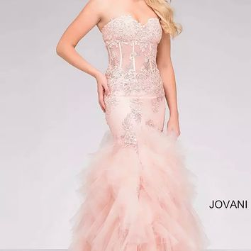 Blush Trumpet strapless corset bodice prom dress with tiered skirt and enbroidery.
