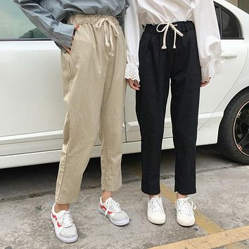 High Waisted Relaxed Fit Trousers