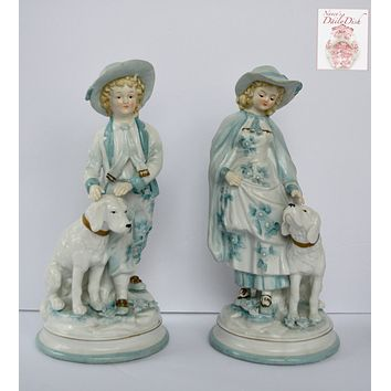 Pair Vintage Parisian French Country Figurines Boy and Girl with Dogs Pale Blue Flowers