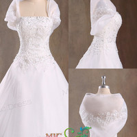 Strapless sleeveless floor-length ball gown with flowers and bows wedding dress