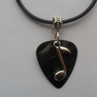 Real guitar pick necklace with music note charm and adjustable chain.