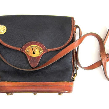 vintage DOONEY and BURKE authentic leather handbag across body purse. navy blue and brown