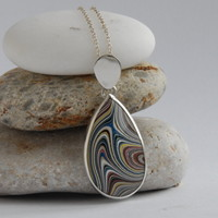 Sterling silver and swirly blue and yellow fordite pear shaped pendant