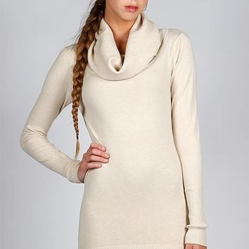 It's buttery soft knit sweater dress, features a ribbed cowl neck, long sleeves with ribbed trim, form fitting and finish with ribbed bottom hemline. Unlined. Pair with Freebird by Steven Coal boots.