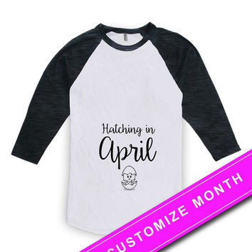 Easter Pregnancy T Shirt Baby Announcement Pregnancy Reveal Hatching In April Baby Shower Gift American Apparel Unisex Raglan MAT-495