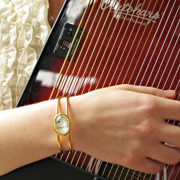 Bracelet with vintage sheet music under glass. Womens jewelry gift for wife, daughter, mother, friend, musician, music lover