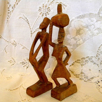 Pair African figurines hand carved redwood drummer and water carrier mid century folk art