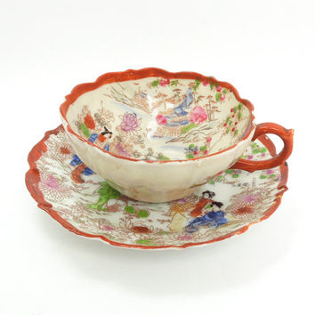 Antique eggshell porcelain teacup and saucer with hand-painted Japanese women and country scenery and red trim